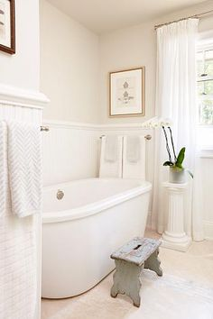 Love the tub and antique stool