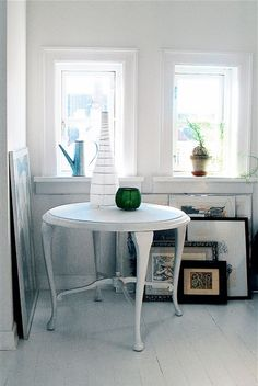 Simple white table allows for clutter on the floor.  #table #white #clutter