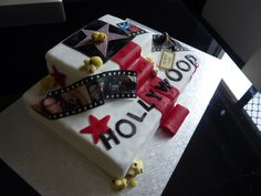 Hollywood movie theme cake - Hollywood theme cake with photos on film strip on edible icing. With red carpet.