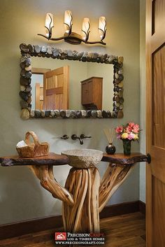 This is so my husband! Log Home Bathroom | Milled Log Home | PrecisionCraft Log Homes by PrecisionCraft Log Homes & Timber Frame, via Flickr-- I'm rock crazy I love the rock framed mirror.