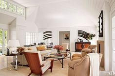 Twin French Art Deco zebrawood side tables are joined by Art Deco armchairs covered in a Rogers & Goffigon fabric in the East Hampton residence of David Kleinberg.