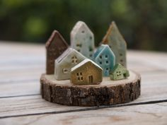 wood slice & houses ... would be cute for Christmas  (just realized there's an awesome wood slice on the porch from the Christmas tree...)