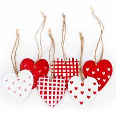 Wooden box of 24 wooden heart-shaped decorations, hand painted with a mixture of gingham, hearts and stars so no two are the same - £9.95 #RNLI