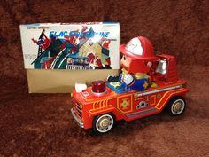 Flag Fire Engine Car. Battery Op Tin Toy 70s.