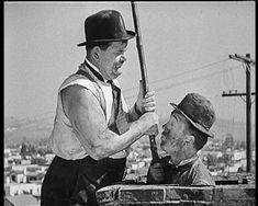Oliver Hardy and Stan Laurel in a mishap.