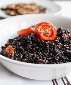 Post image for Black Rice Risotto with Roasted Tomato and Aubergine; http://www.foodrecipeshq.com/black-rice-risotto-with-roasted-tomato-and-aubergine/