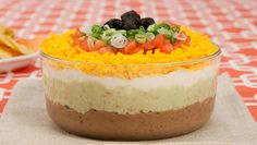 Layered Mexican Dip - Recipes - Best Recipes Ever - This lightened-up version of a crowd-pleasing favourite adds colour to your next party spread. Finger Food Appetizers, Best Appetizers, Appetizer Recipes, Snack Recipes, Snacks, Mexican Dip Recipes, Mexican Dips, Paleo Keto Recipes, My Recipes