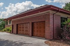 Fiberglass Garage Doors Strength and design come together to carefully craft our fiberglass garage doors. Boasting graceful arches and daring details, these exceptional garage doors set the stage for the rest of your home. Unique Garage Doors, Sliding Garage Doors, Garage Door Hardware, Wooden Garage Doors, Garage Door Styles, Fiberglass Garage Doors, Screen Door Rollers, Sectional Garage Doors, Big Doors