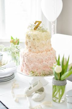 A beautiful blush ombre rosette cake is the perfect centrepiece at any feminine and whimsical birthday party. Learn how to make it with these simple steps | A Burst of Beautiful