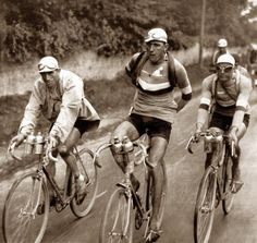 Yellow jersey wearer Antonin Magne (left) with teammates Charles Pélissier (center), and André Leducq on the final stage of the 1931 Tour de France