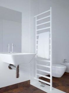 Gekko towel radiator is particularly ideal for modern bathrooms both as a towel rail and as a room divider. This handy bathroom radiator is suitable for any conventional heating system. Mirror Radiator, Towel Radiator, Bathroom Radiators, Central Heating Radiators, Bright Homes, Shabby, Lounge Decor, Round House, Towel Rail