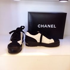 Chanel black and white sneaker. Size 5.5. Please call (949) 715-0004 for all inquiries.