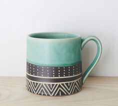 Mug // by Jessica Wertz - Love the simple glaze on top with the patterned underglaze on the bottom.