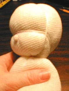 Waldorf doll head tutorial. This tute has the good advice to sew a running stitch for some of the parts for easier gathering.
