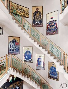 Valentino Garavani's Asian-Inspired Château Near Paris ~ Chinese ancestor portraits from the early 19th century line the curving staircase.