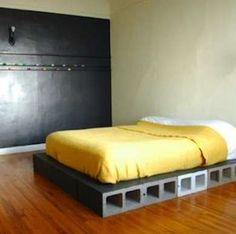 "DIY Bed Frame - 16 You Can Make Yourself - Bob Vila Cinder block idea makes me think of ""yes! a place for shoes!"