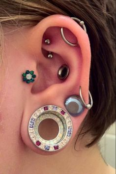 the flower in the tragus is Industrial Strength. tragus, double stretched ears, punched conch, rook, orbital.
