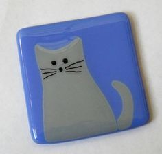 This eye catching cat coaster is handmade in fused glass. A great gift for any cat lover. It is solid fused glass with small rubber bumps on the back to protect your surfaces. This listing is for ONE coaster. Photos show the white and black options. You can also request another