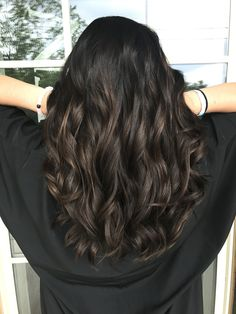 Dark brown hair with subtle peekaboo highlights