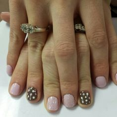 Shellac Cake Pop and Shellac Rubble with white glitter on middle and nail art polka dots on ring finger