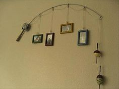 Old fishing rod and reel picture hanger…LOVE this idea for holding old photos!! Just a pic. No directions, but it's pretty much self-explanatory. Can't wait to make one! :-)
