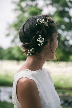 Halo Wedding Plait with Gypsophila | A pretty blue summer Stoke Newington wedding. Bride wears dress by Charlie Brear. Photography by Caro Photo