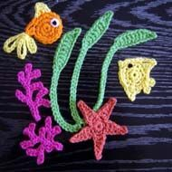 Best sea creatures crochet appliques I have found!  http://www.beginner-crochet-patterns.com/fish-appliques.html#
