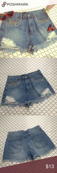 """High waisted shorts High waisted medium wash shorts with distressing on front and studs. Washed never worn. Waist measures 15"""" across when laying Flat. Size says large. ❌ No trades  No ️ay️al ⛔️ No Ⓜ️ercari  Ask me about bundles  Reasonable offers considered  Love Culture Shorts Jean Shorts"""
