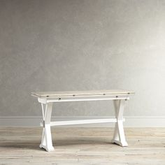 Birch Lane Grafton Console Table With its farmhouse-inspired design, this drop-leaf console table features an antiqued white X-shaped base and a distressed grey wood top. A piano-hinged top extends for use as a desk or table, and folds in for a more compact size when needed.