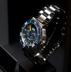 Oris Tubbataha Limited Edition.  An Underwater Sanctuary. The dark orange Superluminova of the Oris Tubbataha Limited Edition indexes and hands are emphasised by contrasting dark blue face of the watch, ensuring the time can be tracked at a quick glance. #oris #limitededition #tubbataha #divers