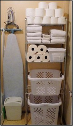 Organizing a small laundry room, the toilet paper in the laundry room would give me so much more space in the bathroom! I always keep extra on top of the toilet anyways.