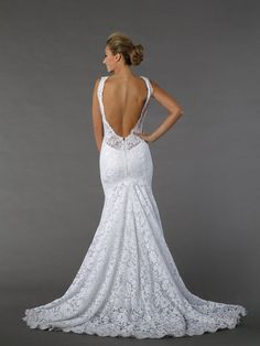Pnina Tornai V-Neck Sheath Gown in Lace. This sheath gown features a v-neck neckline with a natural waist in lace. It has a chapel train and a tank top. It also features a very low cut out back. This gown is Exclusive to Kleinfeld Bridal. It was very comfortable on my wedding day but still refined and sexy (without being too much). Style # 33039249. Kleinfeld currently sells them for ($5001-$8000)
