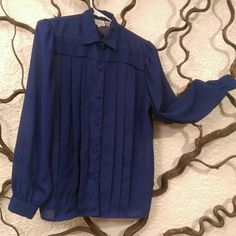 Rich blue button down Comfortable button down looks great dressed up or down. Has pleats and slightly sheer. Shirt is loose fitting on arms!  Fits L-Xl but a d cup might stretch the front buttons. Tops Button Down Shirts