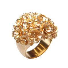 CARLA AMORIM  flowery ring  A tad clumsy, but still lovely with the pure mass of flowers!