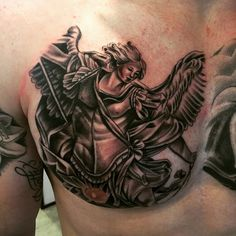 20 Protecting Saint Michael Tattoos - History & Meanings Check more at http://tattoo-journal.com/20-protecting-st-michael-tattoos/