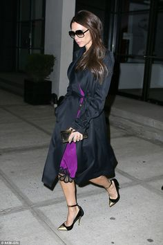 Fashion empire: Victoria chose Monday night to wear one of her elegant violet slip dresses...