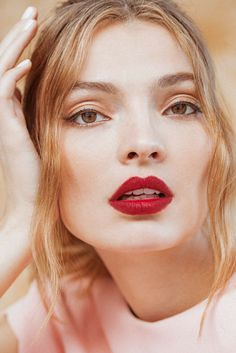 A complexion-warming and teeth whitening shade of red lipstick