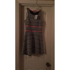 Black and Pink Dress Tank strapped dress, perfect condition, never worn. Tags still attached. Dresses