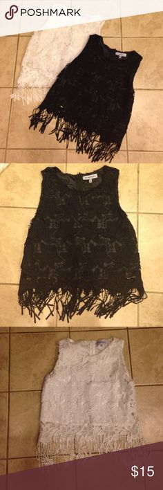 Adorable Lot of Lace and Fringe Tops EUC. Lot of two sleeveless tops. Super cute lace and fringe sleeveless tops. They are black and white. Both are size large. They are longer than a crop top, and fall above the hips. Check out my other listings for bundle deals! Tops