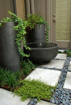 courtyard, paved, stones, features in pots so they can be moved...