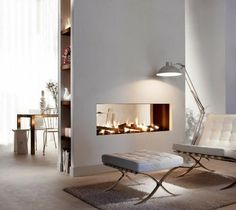 Fireplaces for living room home interior decor: Transparent dual aspect fireplace as room divider with modern light wooden floor, fifties design chair and stool and industrial lamp  #minimalist #modern #interior