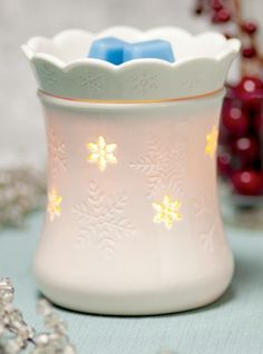 Escape the winter chill with the warm glow of Blizzard. When unlit, Blizzard's snowflakes charm as they fall across the glossy white base and scalloped dish—turn Blizzard on, and perfectly placed cutouts cast a whimsical winter wonderland pattern.    #elegant #snowflakes #warmer #scentsy #winter #wonderland #holidayseason #smellgoodsafely   https://mrsdaniellebaker.scentsy.us/Scentsy/Buy/ProductDetails/DSW-BLIZ