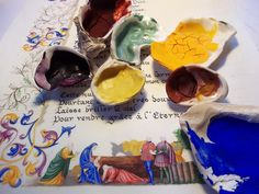 Illuminated manuscript in process with paints in shells.  From Enlumine.org.