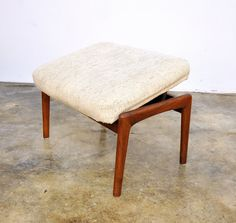 Gorgeous Mid Century Modern teak footstool designed by Folke Ohlsson for Dux, dating from the 60s. Lifts to adjust leg resting height (2