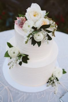 Gorgeous blooms cover this cake: http://www.stylemepretty.com/little-black-book-blog/2015/02/02/romantic-malibu-summer-wedding/ | Photography: Hannah Arista - http://www.hannaharista.com/
