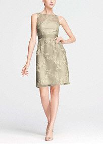 Ultra-feminine and chic, thisdress draws romantic appeal!   Sleeveless bodice features charmingillusion neckline.  Grosgrain ribbon detail at the waist.  Egg shaped skirt iselegant and stylish.  All over embroideryadds texture and is eye catching.  Imported. Back zip. Dry clean only.