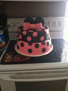 Minnie Mouse cake with fondant and cookies and cream cake