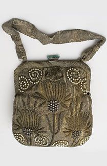 Beaded metallic brocade evening bag, c.1912. Made from metallic silver and gold brocaded silk, the bag is embellished with an Art Nouveau pattern of bronzed gold bullion, faux pearls, and glittering rhinestones.  Lined with ivory silk, the stylish bag has an inner pocket and an attached change purse.