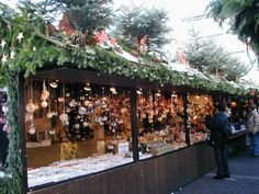 A typical Christmas market stall (either early in the morning or on a weekday) and most of them are decorated with pine tree twigs and cones and if you are in one of those stalls a heater is sometimes hidden just at the feet, otherwise you have blue feet after a day or three weeks of selling in the cold.