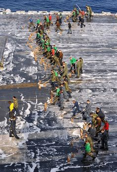 "retrowar: ""Sailors aboard the aircraft carrier USS George Washington (CVN scrub the flight deck "" Navy Aircraft, Military Aircraft, Go Navy, Us Navy Ships, Navy Military, Flight Deck, United States Navy, Aircraft Carrier, Battleship"